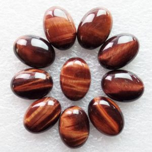 red tiger eye cabochon