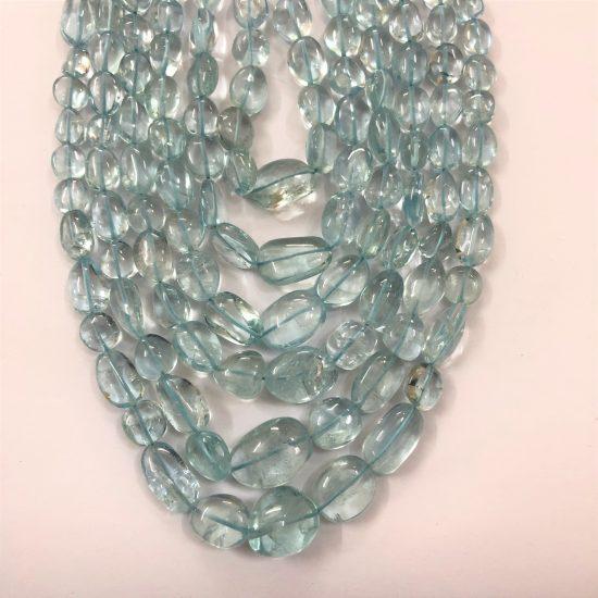 Shop Blue Aquamarine Smooth Tumble Nuggets Beads